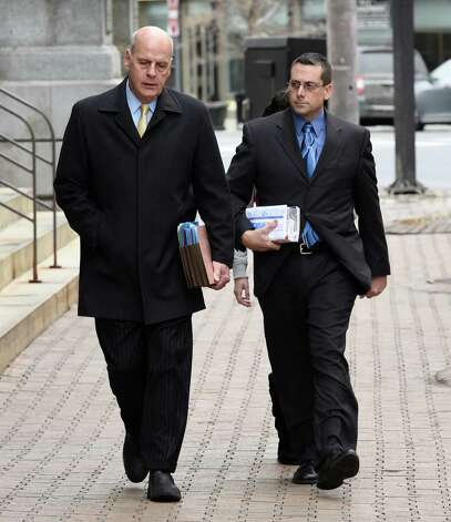 Former Saratoga County sheriff's deputy Charles E. Fuller, 46, right, enters the James T. Foley Federal Courthouse accompanied by his attorney Stephen R. Coffey Thursday morning Dec. 18, 2014, in Albany, N.Y. Fuller was to plead guilty to cocaine trafficking.   (Skip Dickstein/Times Union) Photo: SKIP DICKSTEIN / 00029922A