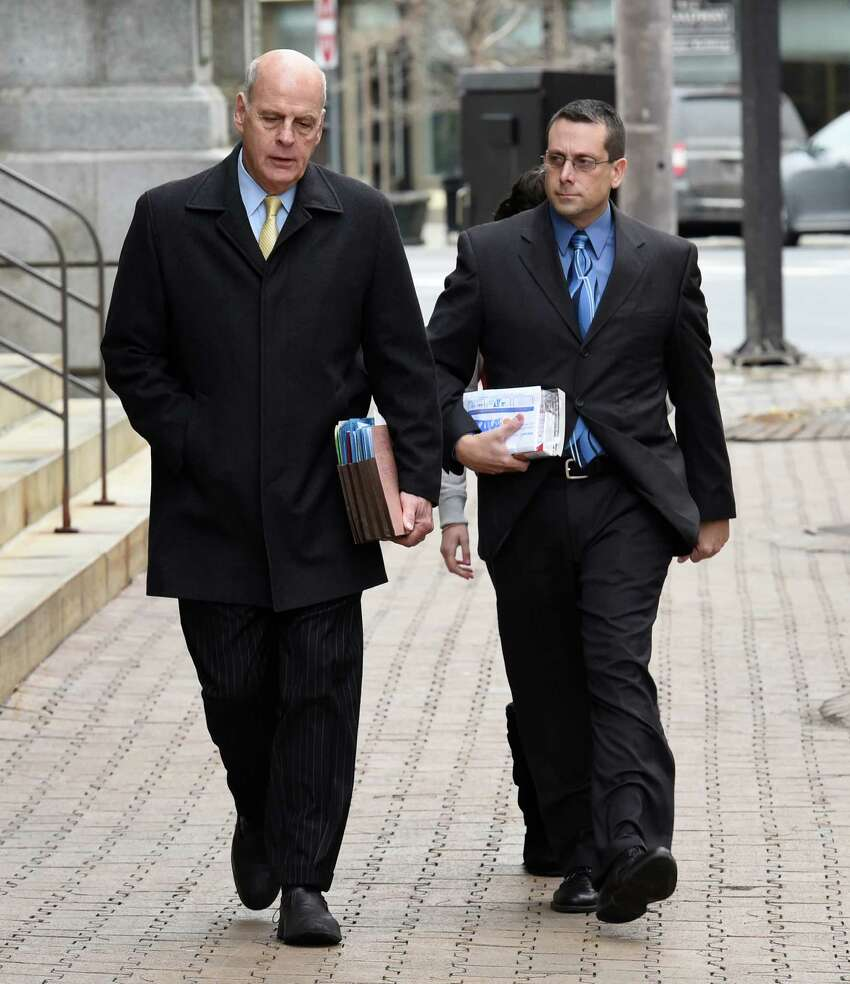 Former Saratoga County sheriff's deputy Charles E. Fuller, 46, right, enters the James T. Foley Federal Courthouse accompanied by his attorney Stephen R. Coffey Thursday morning Dec. 18, 2014, in Albany, N.Y. Fuller was to plead guilty to cocaine trafficking. (Skip Dickstein/Times Union)