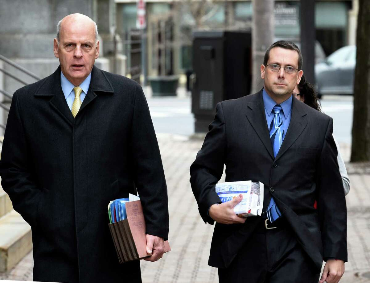 Former Saratoga County sheriff's Deputy Charles E. Fuller, 46, right, enters the James T. Foley Federal Courthouse accompanied by his attorney Stephen R. Coffey Thursday morning Dec. 18, 2014, in Albany, N.Y. Fuller was sentenced to five years in prison for cocaine trafficking after being snared in an FBI sting. (Skip Dickstein/Times Union)