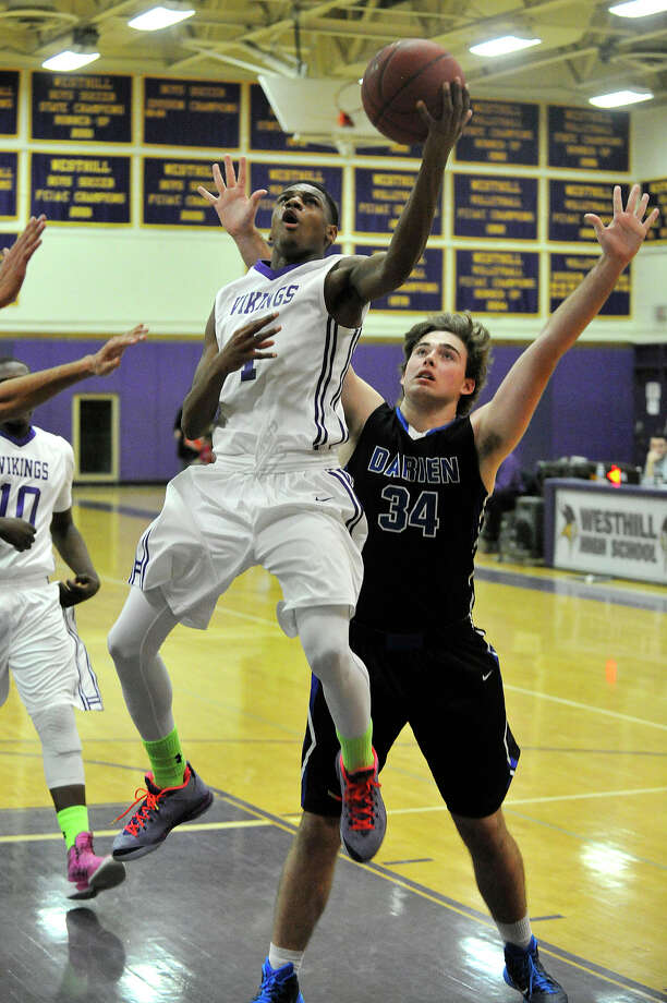 Westhill's Jeremiah Livingston puts up a shot while under pressure from behind from Darien's Casey Brown during their basketball game at Westhill High School in Stamford, Conn., on Wednesday, Dec. 17, 2014. Westhill won, 64-43. Photo: Jason Rearick / Stamford Advocate
