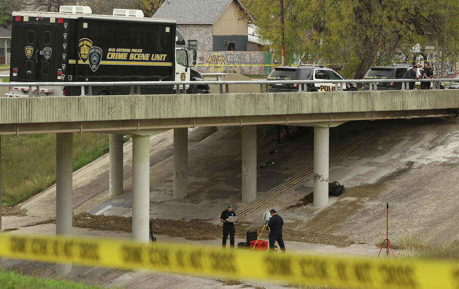 San Antonio police work Thursday December 18, 2014 near Apache Creek and the 2400 block of Vera Cruz where the nude body of a woman in her late teens or early 20s was found under a bridge. Police are currently investigating the scene. Photo: JOHN DAVENPORT, San Antonio Express-News / ©San Antonio Express-News/John Davenport