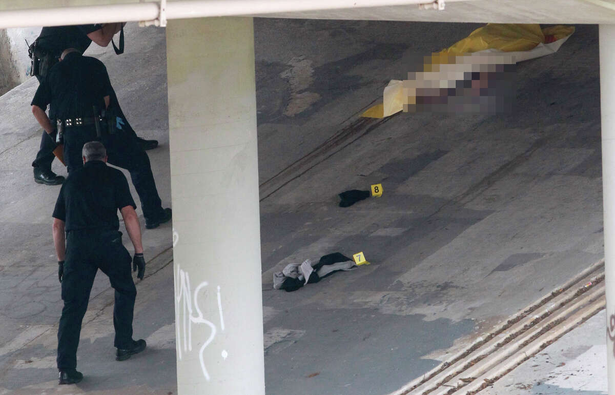 San Antonio police work Thursday December 18, 2014 near Apache Creek and the 2400 block of Vera Cruz where the nude body of a woman in her late teens or early 20s was found under a bridge.