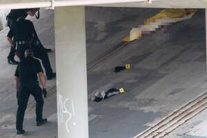 San Antonio police work Thursday December 18, 2014 near Apache Creek and the 2400 block of Vera Cruz where the nude body of a woman in her late teens or early 20s was found under a bridge. Police are currently investigating the scene.