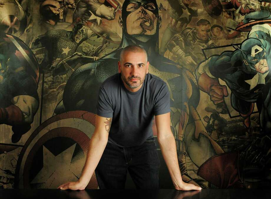 """Editor in chief Axel Alonso, at Marvel Comics' New York offices, says of changing superheroes' race and sex, """"Roles in society aren't what they used to be. There's far more diversity."""" Photo: Judith Stephens / Associated Press / Marvel Entertainment"""