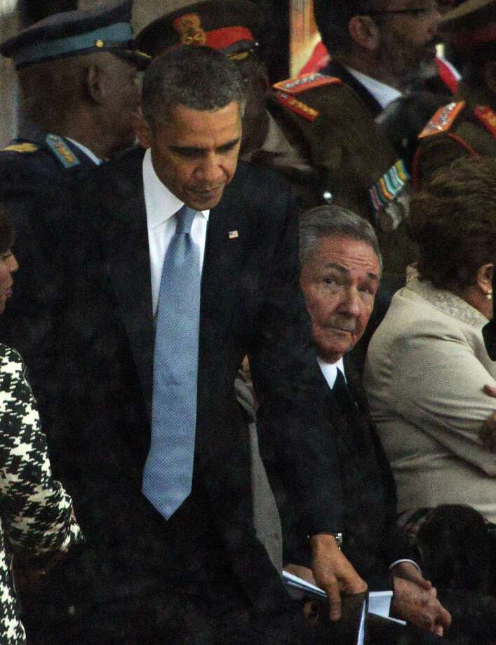 Obama and Castro crossed paths, briefly, at 2013 memorial for Nelson Mandela. Photo: ROBERTO SCHMIDT / AFP/Getty Images / AFP