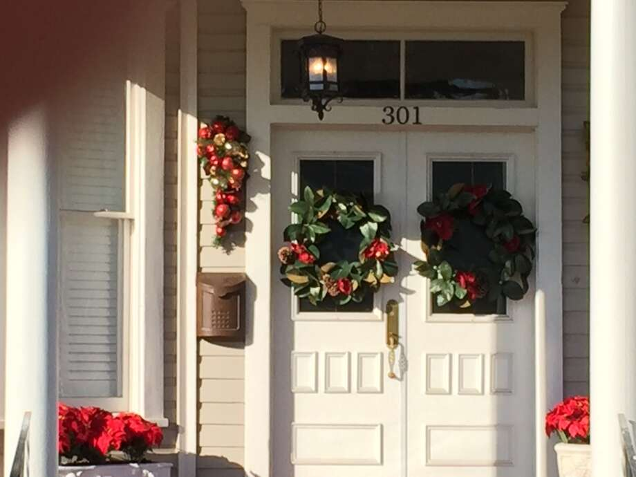 Christmas wreaths adorn most doors around the historic Monte Vista neighborhood, putting one in the mood for eggnog and curling up in front of the fire. Photo: Emily Spicer / San Antonio Express-News