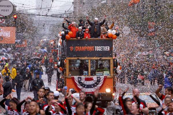Giants' pitcher Jeremy Affeldt, waves to fans along the confetti filled route, as the world champion San Francisco Giants celebrate their victory with a parade through downtown San Francisco, Calif., on Friday Oct. 31, 2014.