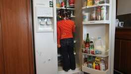 Ariyahn Hills, 4, searches for oranges in the fridge in the kitchen at her family's apartment March 8, 2014 in Ingleside in San Francisco, Calif. The new design for Nutrition Facts labels on food packages, proposed by the FDA, might help families similar to Calloway's. Rheema's Aunt, who has both cerebral palsy and diabetes, has to have her diet monitored carefully. Rheema's sister, Rheneka, also has diabetes.