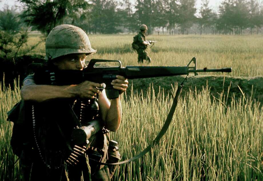 An American soldier firing his M16 rifle during the My Lai massacre on March 16, 1968 in My Lai, South Vietnam. Military veterans and the general gun-buying public were increasingly fascinated with the AR-15, the civilian version of the M-16 that was standard-issue in the Vietnam War. Photo: Ronald L. Haeberle, The LIFE Images Collection/Getty / Ronald L. Haeberle Photo by Ronald S. Haeberle/The LIFE Images Collection/Getty Images Getty  Connecticut Post contributes