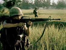 An American soldier firing his M16 rifle during the My Lai massacre on March 16, 1968 in My Lai, South Vietnam. Military veterans and the general gun-buying public were increasingly fascinated with the AR-15, the civilian version of the M-16 that was standard-issue in the Vietnam War.