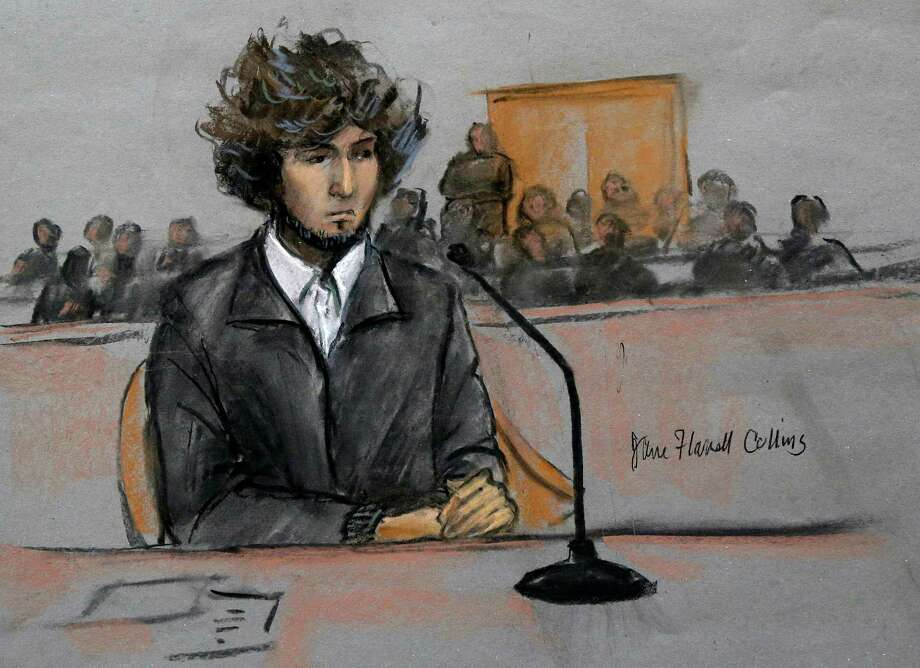 In this courtroom sketch, Boston Marathon bombing suspect Dzhokhar Tsarnaev is depicted sitting in federal court in Boston Thursday, Dec. 18, 2014, for a final hearing before his trial begins in January. Tsarnaev is charged with the April 2013 attack that killed three people and injured more than 260. He could face the death penalty if convicted.  (AP Photo/Jane Flavell Collins) Photo: Jane Flavell Collins / Associated Press / Jane Flavell Collins