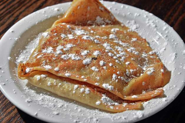 Apple caramel crepe at the Whistling Kettle on Broadway Friday Dec. 12, 2014, in Troy, NY.  (John Carl D'Annibale / Times Union) Photo: John Carl D'Annibale / 00029830A