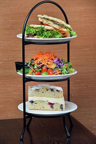 An afternoon tea build-your-own with, from top, spicy Thai roast beef, house salad and lemon berry marscapone cake at the Whistling Kettle on Broadway Friday Dec. 12, 2014, in Troy, NY.  (John Carl D'Annibale / Times Union) Photo: John Carl D'Annibale / 00029830A