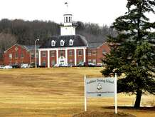 The main building of Southbury Training School is shown here.