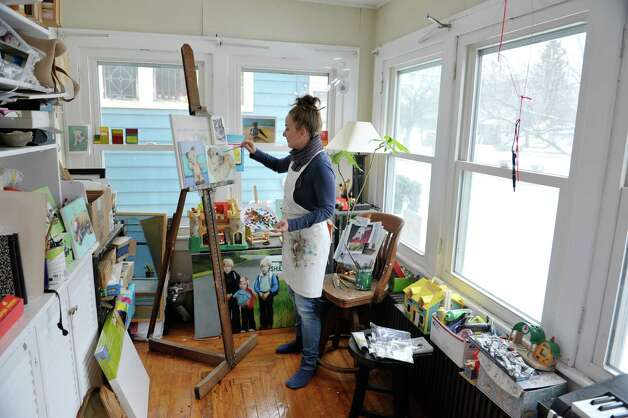 Artist Jennifer Maher works on a painting in her studio on Wednesday, Dec. 10, 2014, in Ballston Spa, N.Y.  (Paul Buckowski / Times Union) Photo: Paul Buckowski / 00029792A
