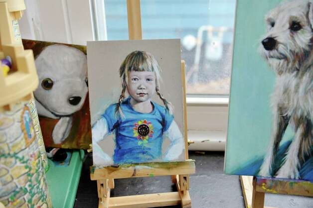 Paintings by artist Jennifer Maher, including one of her daughter, Sonja,  are seen in her studio on Wednesday, Dec. 10, 2014, in Ballston Spa, N.Y.  (Paul Buckowski / Times Union) Photo: Paul Buckowski / 00029792A