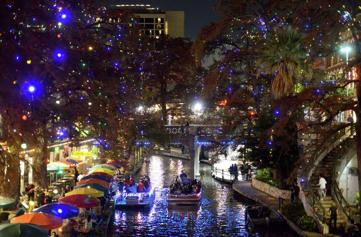 1. Take a River Walk tour by boat during the holiday season The twinkling lights dangling from the century-old trees, reflecting on the waters is one of the most picturesque San Antonio scenes. Be part of the image by riding a river barge while taking in the glowing scenery.