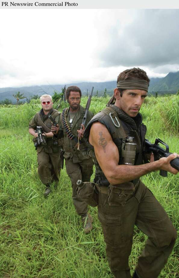 "Jack Black, Robert Downey Jr. and Ben Stiller play actors shooting a war movie who get caught up in a real battle in the action comedy ""Tropic Thunder."" DreamWorks Pictures Presents A Red Hour Production A Ben Stiller Film ""Tropic Thunder"" starring Ben Stiller, Jack Black Robert Downey Jr., Brandon T. Jackson, Jay Baruchel, Danny McBride, Steve Coogan, Bill Hader and Nick Nolte. In theatres August 15th. Credit: Merie Weismiller Wallace.  (PRNewsFoto/Paramount Pictures) / PARAMOUNT PICTURES"