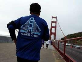 Francisco Campos of Mexico runs on the walkway of the Golden Gate Bridge during the 2014 San Francisco Marathon.