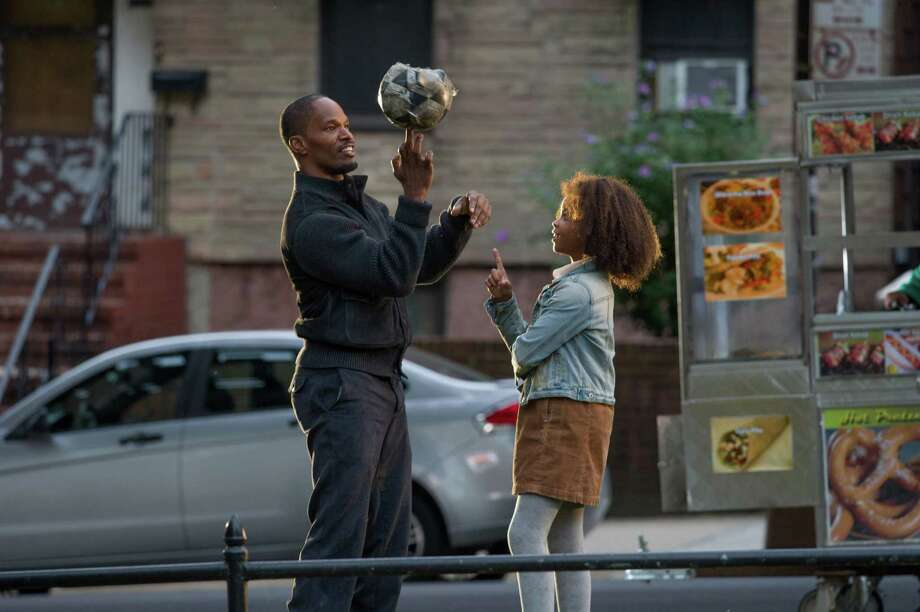 """This photo released by Colombia Pictures -  Sony shows Jamie Foxx, left, as Will Stacks and Quvenzhane Wallis as Annie in a scene from Columbia Pictures' """"Annie."""" (AP Photo/Columbia Pictures - Sony, Barry Wetcher) ORG XMIT: CAET101 Photo: Barry Wetcher / Columbia Pictures - Sony"""