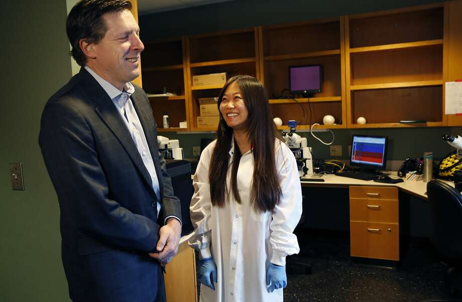 Brian Kennedy, PhD, CEO and President of the Buck Institute for Research on Aging, left, poses with Chong He, Postdoctoral Fellow, for media members in their lab space Dec. 18, 2014 in Novato, Calif. A new study at the institute has found that ibuprofen has life-extending properties when tested with yeast, worms and fruit flies. Photo: Leah Millis, The Chronicle