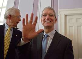 Apple CEO and Alabama native Tim Cook waves to the crowd before he is honored at an event in Mortgomery in October.