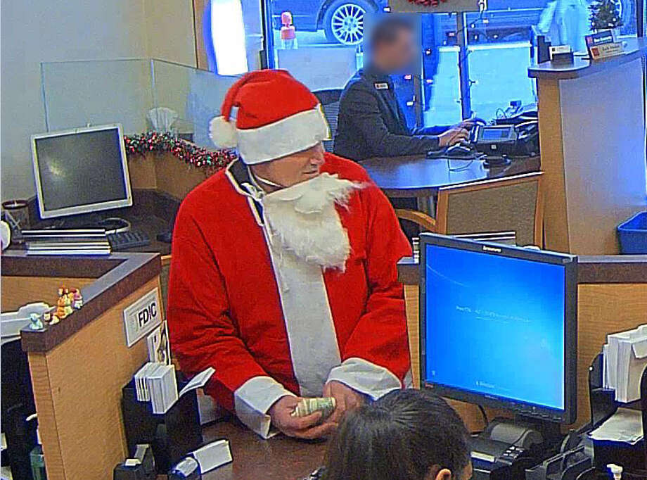 This man, dressed in a Santa suit, is suspected of robbing a San Francisco bank during SantaCon. Photo: San Francisco Police / ONLINE_YES