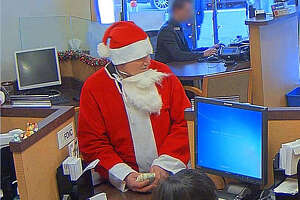 Pics released of Santa bandit who robbed bank during SantaCon - Photo