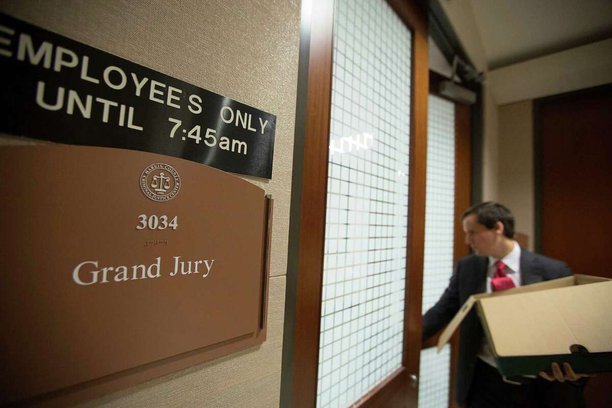 A man enters the office area where the Harris County grand jury meets Thursday, Dec. 18, 2014, in Houston. The grand jury will meet again on Tuesday to decide whether to indict or clear Houston Police Department Officer Juventino Castro in the January shooting of 26-year-old Jordan Baker.