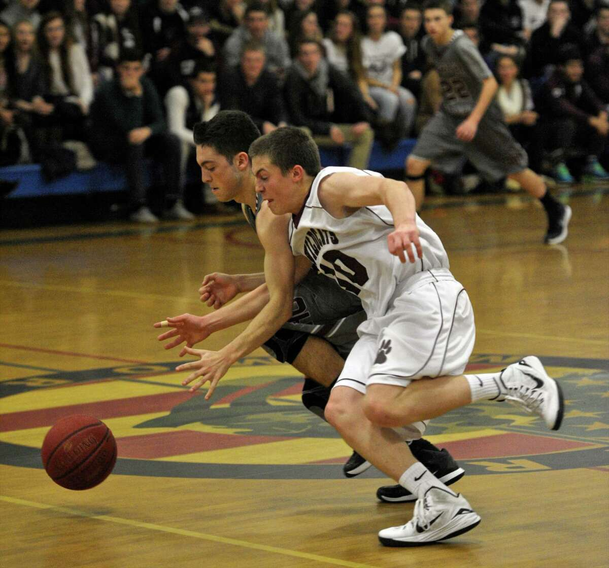 Bethel's joseph Liquori (10) steals the ball from North Haven's Bill Sgro (20) during the News Times Greater Danbury Tip Off Classic first round boys varsity game between the New Haven Indians and the Bethel Wildcats, on Thursday night, December 18, 2014, played at the Danbury War Memorial, Danbury, Ct.