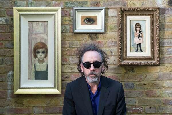 Director Tim Burton with Margaret Keane paintings.