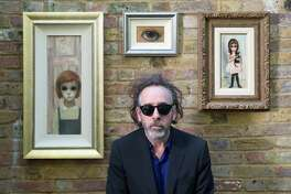 Director Tim Burton with Margaret Keane paintings.