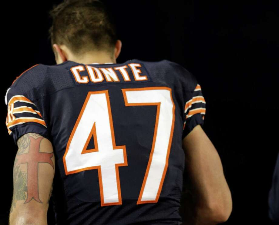 Chicago Bears free safety Chris Conte leaves the game during the second half of against the Dallas Cowboys on Dec. 4, 2014, in Chicago. Photo: Nam Y. Huh /Associated Press / AP