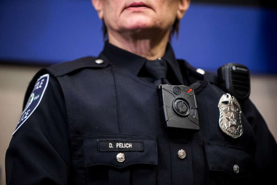 Seattle Police Department officers show off their new body-worn cameras and accompanying new uniforms Thursday, Dec. 18, 2014, at City Hall in downtown Seattle, Washington. (Jordan Stead, seattlepi.com) Photo: JORDAN STEAD, SEATTLEPI.COM