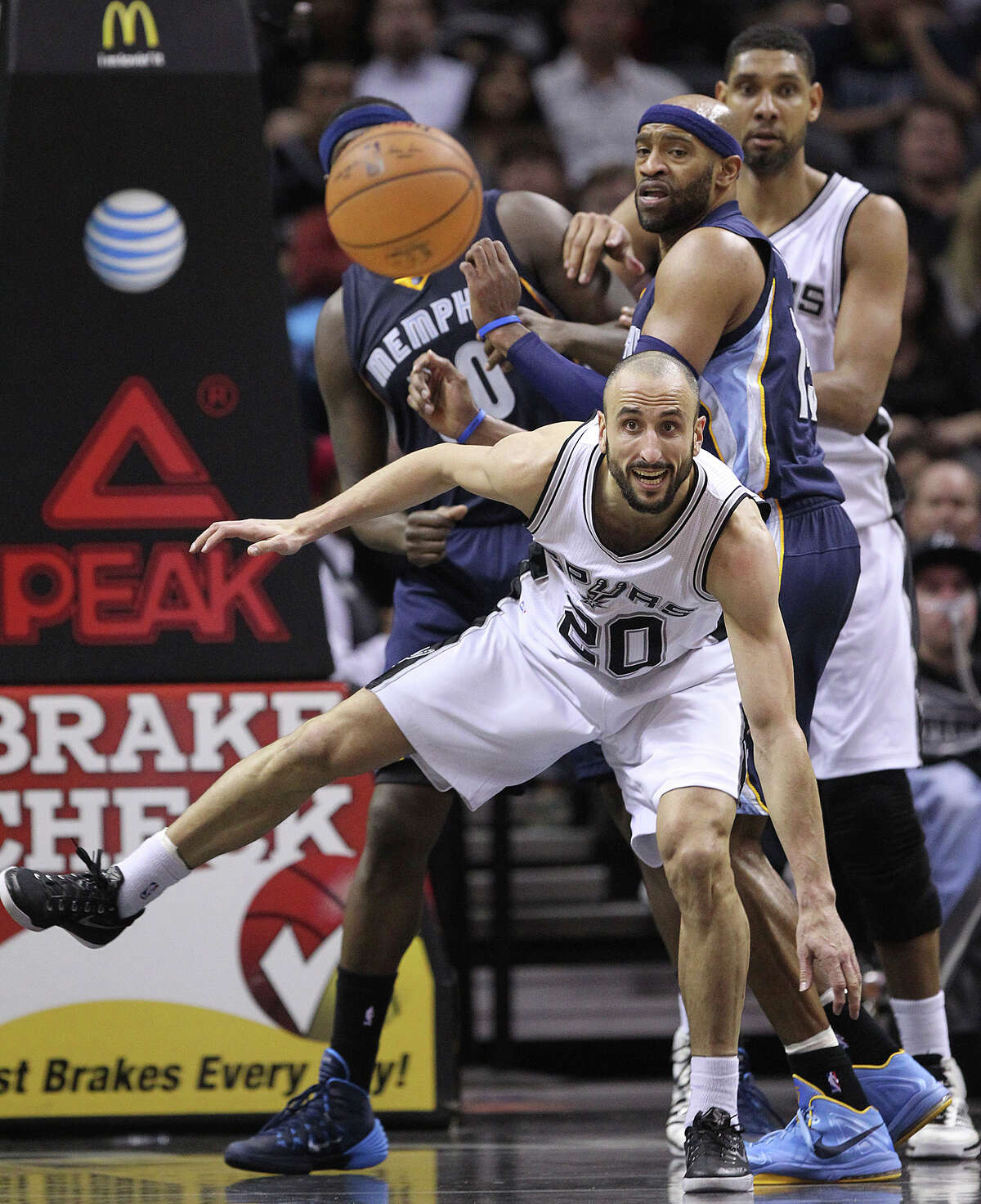The bouncing ball, and victory, eluded Manu Ginobili (front), Tim Duncan (back) and the Spurs in Wednesday's triple-OT loss to Memphis. Tonight marks a quick turnaround against Portland.