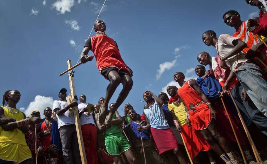 combo cap here A Maasai warrior makes the high jump, in which athletes must touch a high line with the top of their heads, at the annual Maasai Olympics in the Sidai Oleng Wildlife Sanctuary near to Mt. Kilimanjaro, in southern Kenya, Saturday, Dec. 13, 2014. Maasai men and women from the Amboseli and Tsavo region compete for medals and prizes in the event which aims for a sports competition of Maasai skills such as running, jumping, and throwing, to replace lion-hunting as the traditional warrior activity. (AP Photo/Ben Curtis) Photo: Ben Curtis / Associated Press / AP