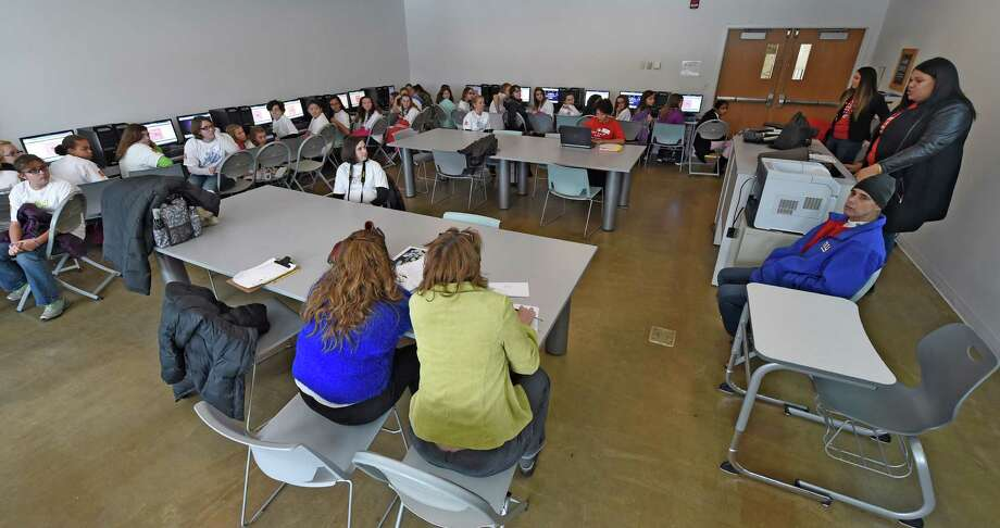 Students work on their coding projects at the Annual Girls Summit held at the Tec-Smart center Thursday morning Dec. 18, 2014 in Malta, N.Y.  (Skip Dickstein/Times Union) Photo: SKIP DICKSTEIN / 00029908A