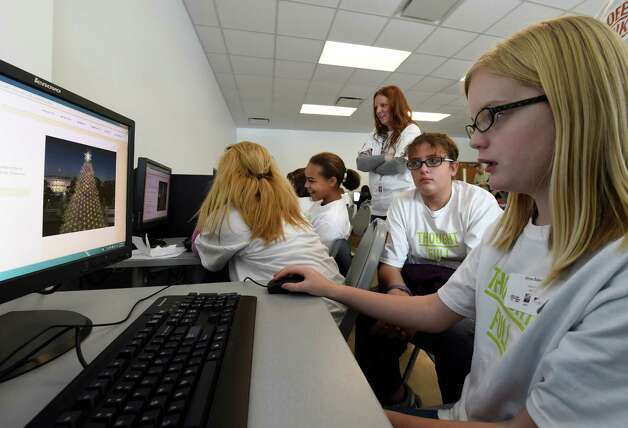 Alyssa Baker, 12, works on her coding project at the Annual Girls Summit held at the Tec-Smart center Thursday morning Dec. 18, 2014 in Malta, N.Y.  (Skip Dickstein/Times Union) Photo: SKIP DICKSTEIN / 00029908A