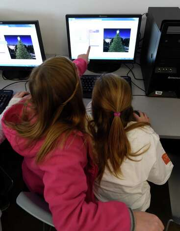 Jordan Brand, 12, left, and Lily Viscusi, 12, of Ballston Spa work on their coding project at the Annual Girls Summit held at the Tec-Smart center Thursday morning Dec. 18, 2014 in Malta, N.Y.  (Skip Dickstein/Times Union) Photo: SKIP DICKSTEIN / 00029908A