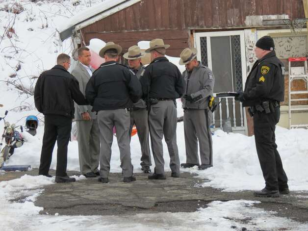 Police and sheriff's deputies converge outside the home on Thacher Park Road in the town of Knox where two men wearing ski masks allegedly abducted 5-year-old Kenneth White. He is described in a state police Amber Alert as 3-foot-5, weighing about 45 pounds and with short brown hair. (Tom Heffernan Sr. / Special to the Times Union) Photo: Picasa