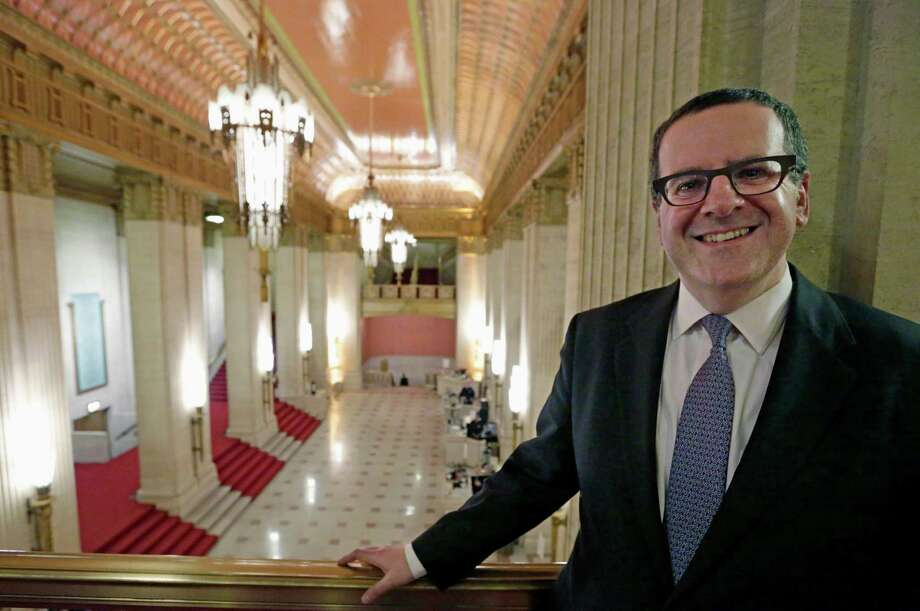 Anthony Freud, general director of the Lyric Opera of Chicago, stands on the mezzanine that overlooks the foyer. Photo: M. Spencer Green / Associated Press / AP
