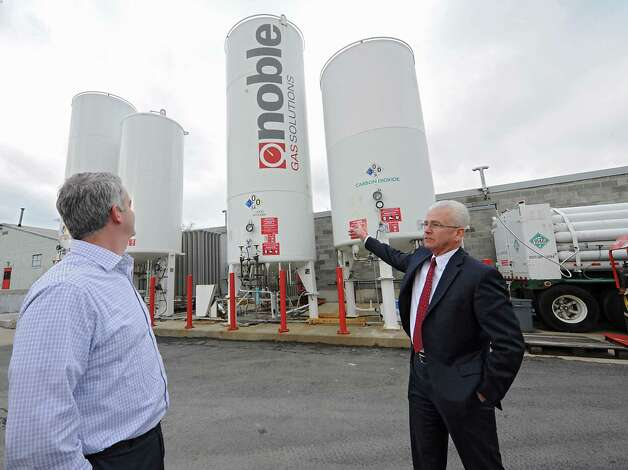 Pat O'Donnell, vice president of sales, left, and Dave Mahoney, president at Noble Gas stand outside of Noble Gas Solutions near the large gas holding tanks on Thursday Dec. 18, 2014 in Albany, N.Y. Noble Gas Solutions provides gases to the nanotech sector among other companies and corporations.  (Lori Van Buren / Times Union) Photo: Lori Van Buren / 00029917A