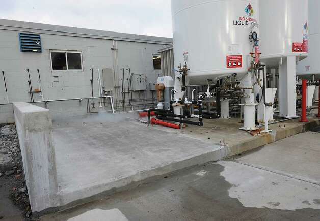An empty spot if ready for the research grade oxygen tank next to the other large gas holding tanks at Noble Gas Solutions on Thursday Dec. 18, 2014 in Albany, N.Y. Noble Gas Solutions provides gases to the nanotech sector among other companies and corporations.  (Lori Van Buren / Times Union) Photo: Lori Van Buren / 00029917A