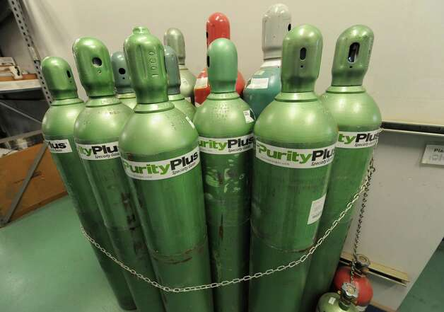 Cylinders of gas are seen at Noble Gas Solutions on Thursday Dec. 18, 2014 in Albany, N.Y. Noble Gas Solutions provides gases to the nanotech sector among other companies and corporations.  (Lori Van Buren / Times Union) Photo: Lori Van Buren / 00029917A