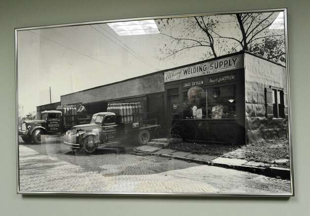 An old company photo is seen in the office of Dave Mahoney, president at Noble Gas Solutions, on Thursday Dec. 18, 2014 in Albany, N.Y. The company used to be named Albany Welding Supply Co.. Noble Gas Solutions provides gases to the nanotech sector among other companies and corporations.  (Lori Van Buren / Times Union) Photo: Lori Van Buren / 00029917A