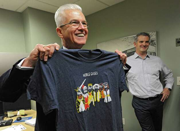 Dave Mahoney, president at Noble Gas Solutions. holds up a company t-shirt in his office on Thursday Dec. 18, 2014 in Albany, N.Y. The company used to be named Albany Welding Supply Co.. Noble Gas Solutions provides gases to the nanotech sector among other companies and corporations.  (Lori Van Buren / Times Union) Photo: Lori Van Buren / 00029917A