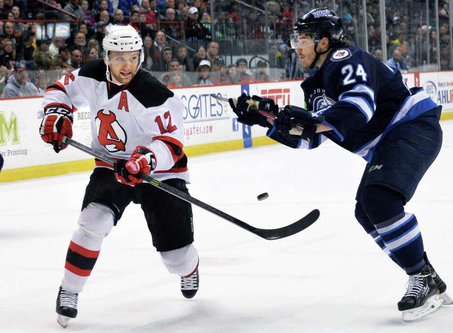 Albany Devils' #12 Tim Sestito, left, and St. John's IceCaps' #24 Zach Redmond during the second game of a best-of-5 American Hockey League playoff series at the Times Union Center Saturday April 26, 2014, in Albany, NY. ( John Carl D'Annibale / Times Union) Photo: John Carl D'Annibale / 00026569A