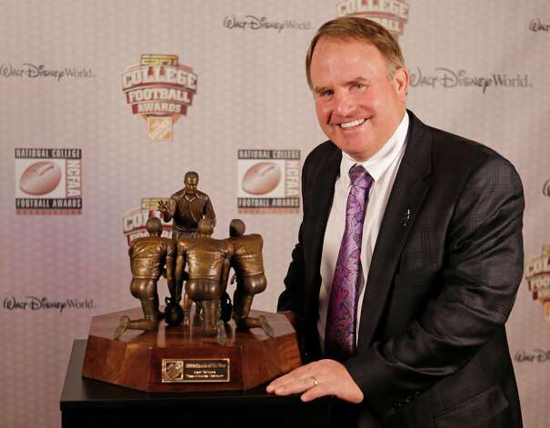 TCU head coach Gary Patterson stands with his trophy after being awarded the Coach of the Year Award at the College Football Awards, Thursday, Dec. 11, 2014, in Lake Buena Vista, Fla. (AP Photo/John Raoux) ORG XMIT: FLJR121 Photo: John Raoux / AP
