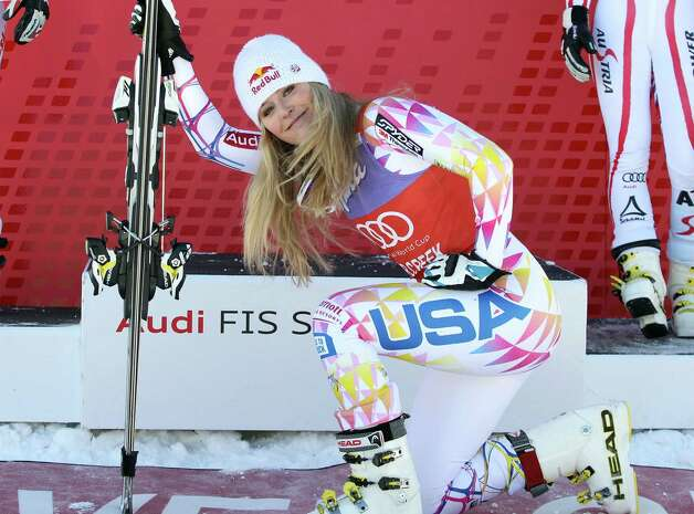 FILE - In this Dec. 7, 2011 file photo, Lindsey Vonn kneels down in front of the podium after winning the women's World Cup Super G  ski competition in Beaver Creek, Colo. Vonn was supposed to make her World Cup return this week on a course almost custom-made for her. But after re-injuring her knee last week, the four-time World Cup champ is sitting this one out. (AP Photo/Alessandro Trovati, File) ORG XMIT: NY154 Photo: Alessandro Trovati / AP