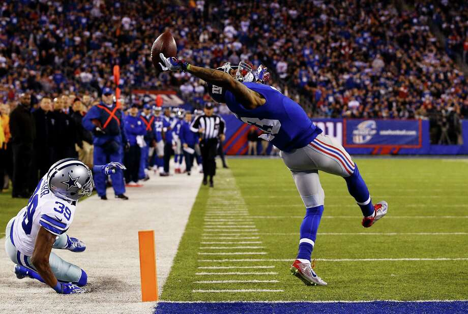 EAST RUTHERFORD, NJ - NOVEMBER 23:  Odell Beckham #13 of the New York Giants scores a touchdown in the second quarter against the Dallas Cowboys at MetLife Stadium on November 23, 2014 in East Rutherford, New Jersey.  (Photo by Al Bello/Getty Images) ORG XMIT: 507869247 Photo: Al Bello / 2014 Getty Images